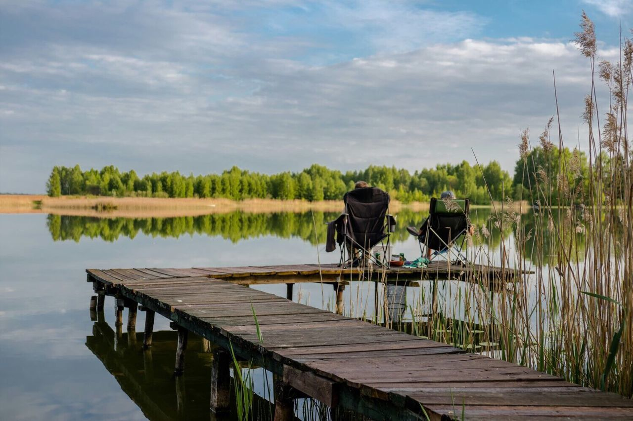 Two people fishing in the lake. Lithuania Lithuania Nature Lake View Lakeshore Lakeside Lake Life Landscape_photography Landscapes Landscape_Collection Landscape Photography Naturelovers Nature_collection Nature Nature_perfection Naturephotography Nature On Your Doorstep Nature Photography Naturelover Nature_ Collection  Lakeview Lakelife Lake Shore Fishing Fishing Time Fishing Rod