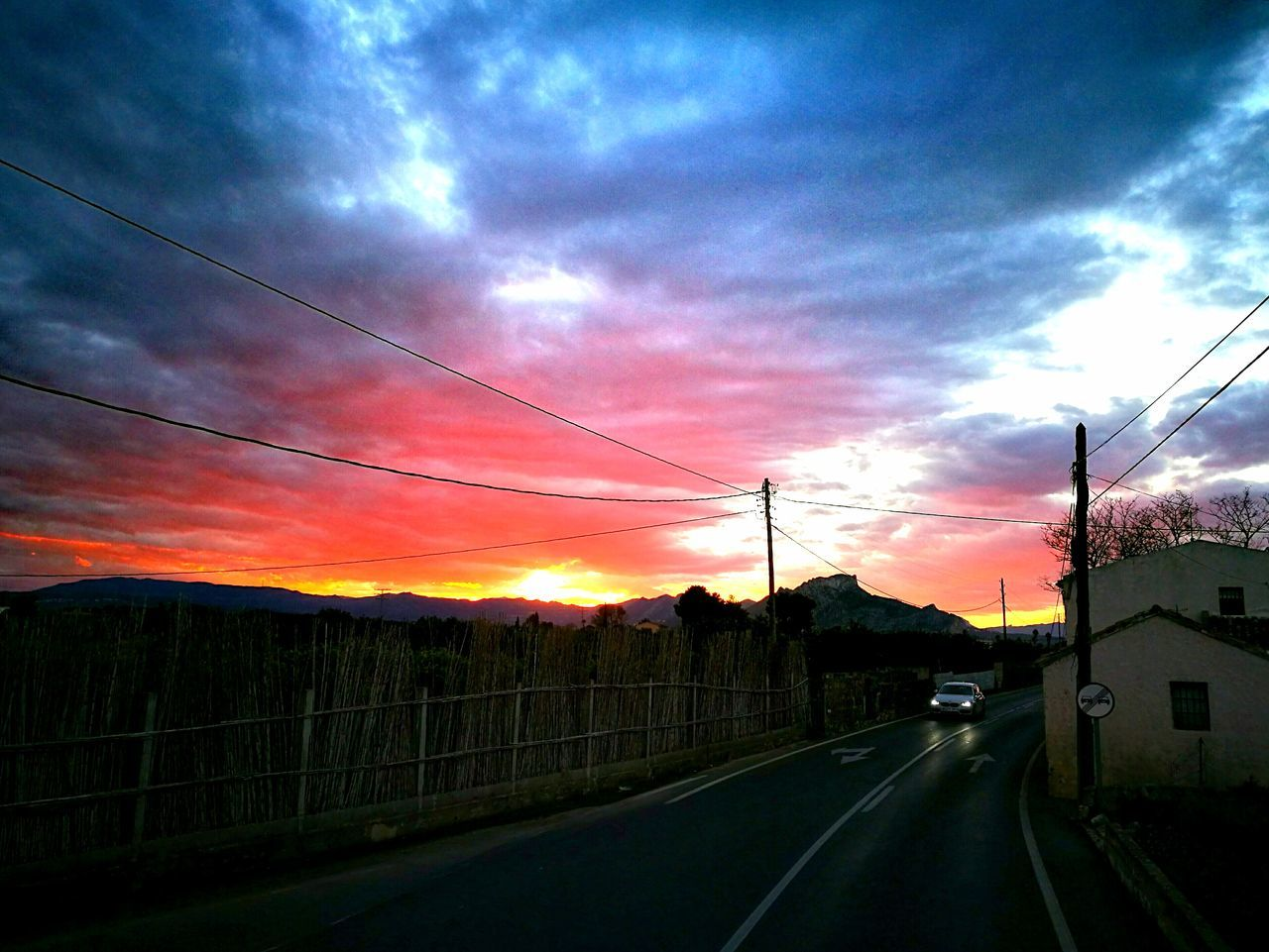 Sunset Dramatic Sky Sky Dusk Nature Rural Scene Road Transportation No People Idyllic Cloud - Sky The Way Forward Beauty In Nature Scenics Tree Outdoors Wet Agriculture Landscape Motion