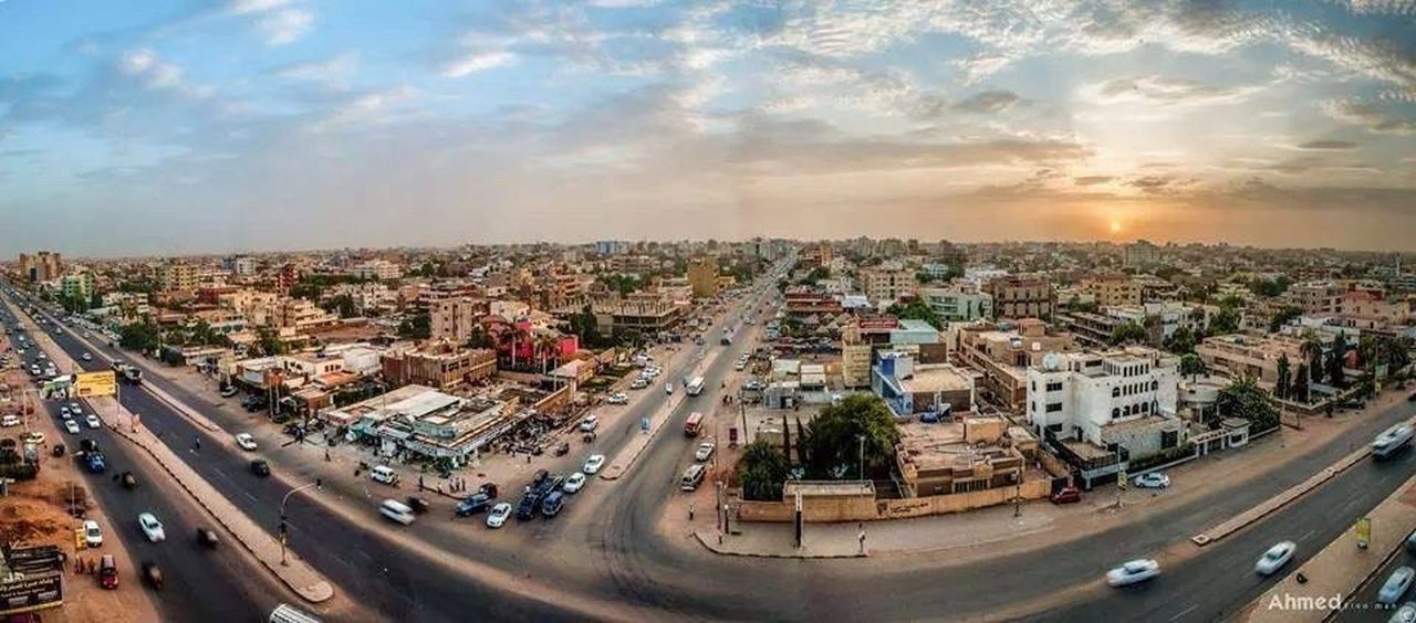 Sudan was Medani City Transportation Cityscape Road High Angle View Architecture Car Building Exterior Built Structure Sunset Land Vehicle Street City Life Sunbeam Sky Traffic Residential Building Aerial View Mode Of Transport Crowded Music Brings Us Together