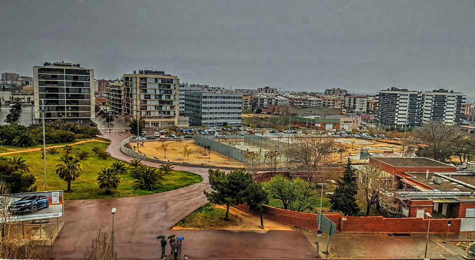 Architecture Building Building Exterior Built Structure City City Life Cityscape Cloud - Sky Cornellà Day Development Elevated View Growth No People Outdoors Residential Building Residential District Residential Structure Sky Town Tree