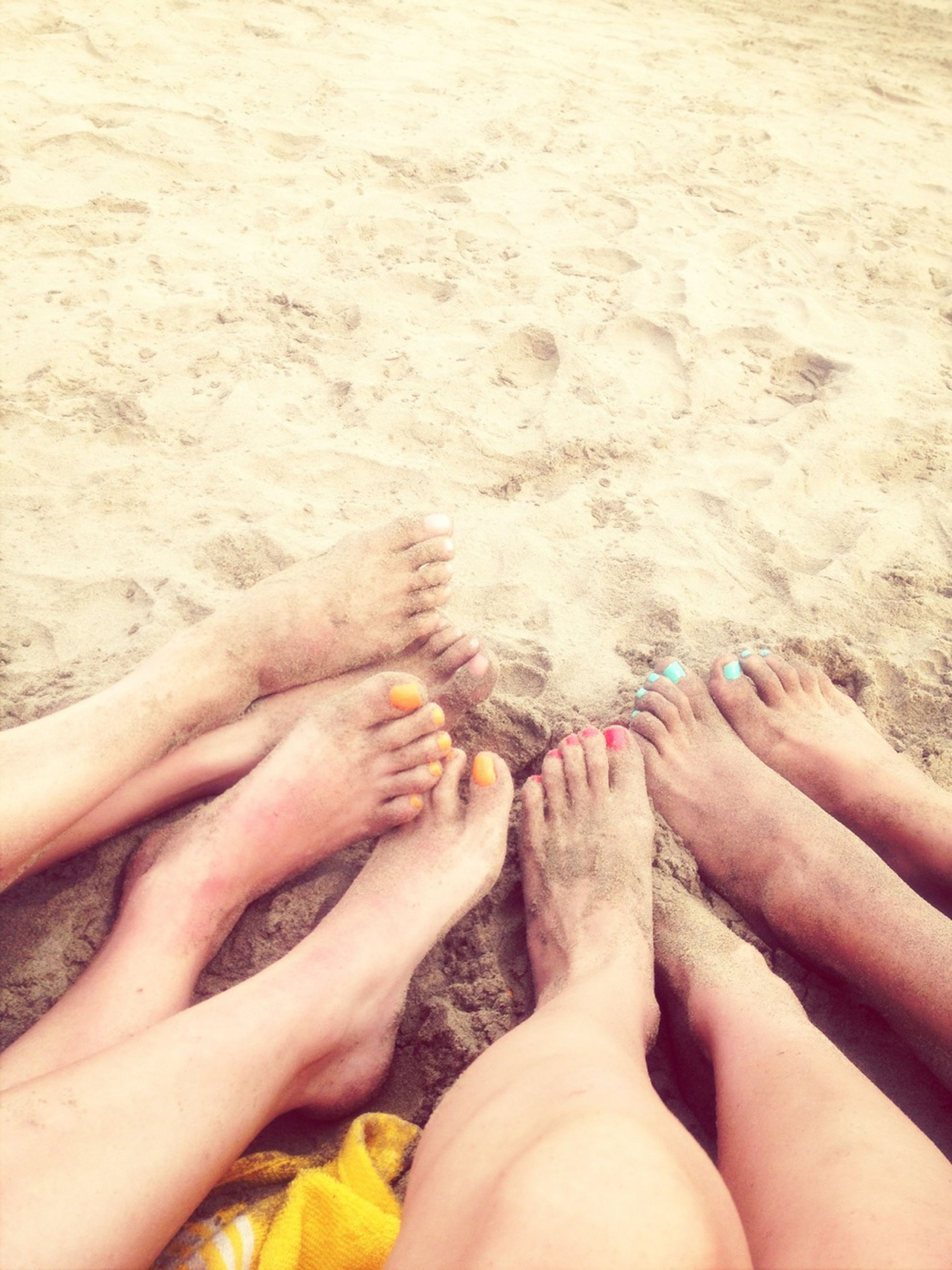 personal perspective, low section, person, barefoot, lifestyles, leisure activity, human foot, beach, sand, part of, high angle view, relaxation, unrecognizable person, togetherness