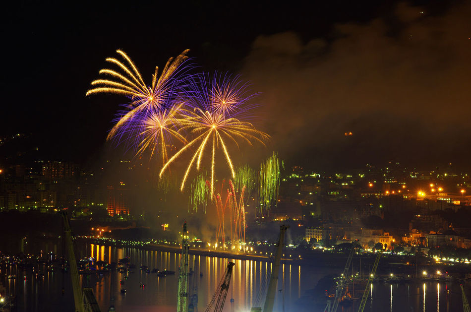 Architecture Arts Culture And Entertainment Building Exterior Built Structure Celebration City Cityscape Event Exploding Firework Firework - Man Made Object Firework Display Illuminated Long Exposure Motion Multi Colored Night No People Outdoors Sky Water