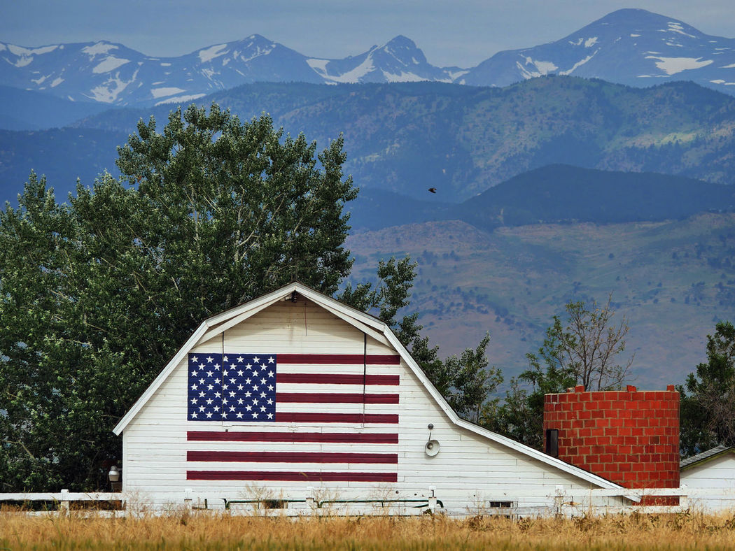 Happy 4th of July! I took this several days ago in Boulder County Colorado so my university can post it to social media channels. Check This Out Patriotic Flag US Flag Stars And Stripes Flag Barn American Flag America Classic Buildings Rocky Mountains Colorado Red White And Blue July 4th Scenic Barns Farm Panasonic GX8Boulder Colorado Showcase July Hidden Gems