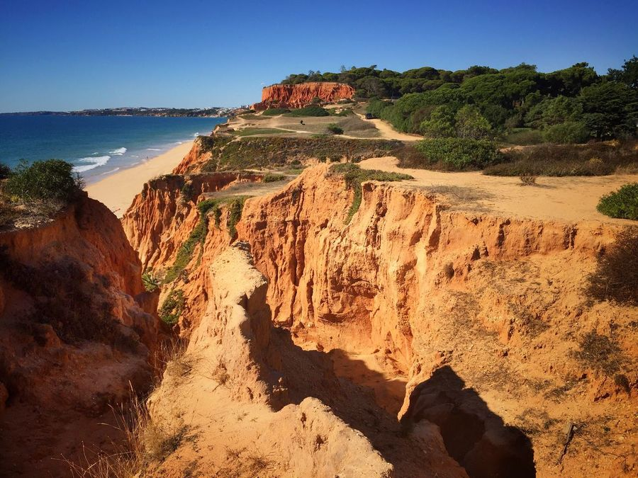 Rock Formation Rock - Object Cliff Nature Beauty In Nature Scenics Tranquil Scene Tranquility Landscape Outdoors No People Day Clear Sky Sunlight Physical Geography Travel Destinations Mountain Sky No Filter No Edit/no Filter Algarve Portugal Beach Nature Waterfront