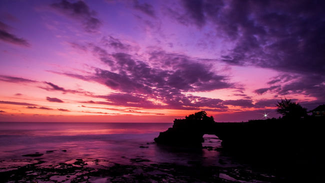 Sunset Tanah Lot Bali, Indonesia Sunset Water Sea Tranquil Scene Scenics Horizon Over Water Tranquility Beach Beauty In Nature Sky Silhouette Idyllic Cloud - Sky Romantic Sky Nature Dramatic Sky Calm Ocean Non-urban Scene Cloud