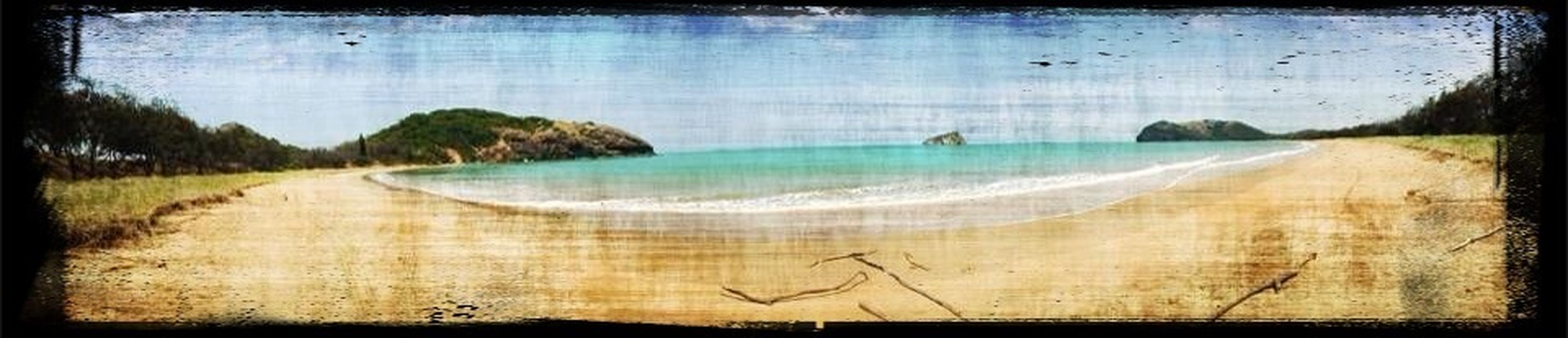 transfer print, water, auto post production filter, sea, sand, beach, tranquil scene, tranquility, scenics, nature, beauty in nature, sky, shore, panoramic, horizon over water, day, outdoors, idyllic, coastline, landscape
