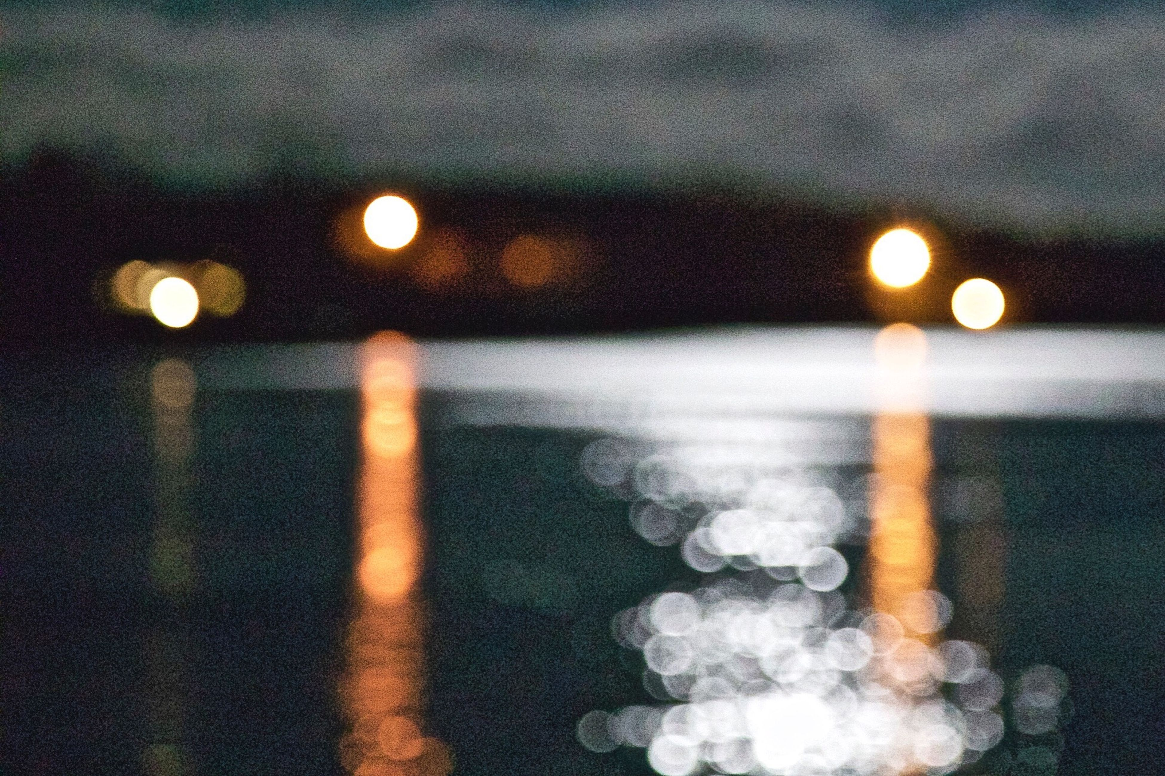 Defocused Lights And Beach At Night