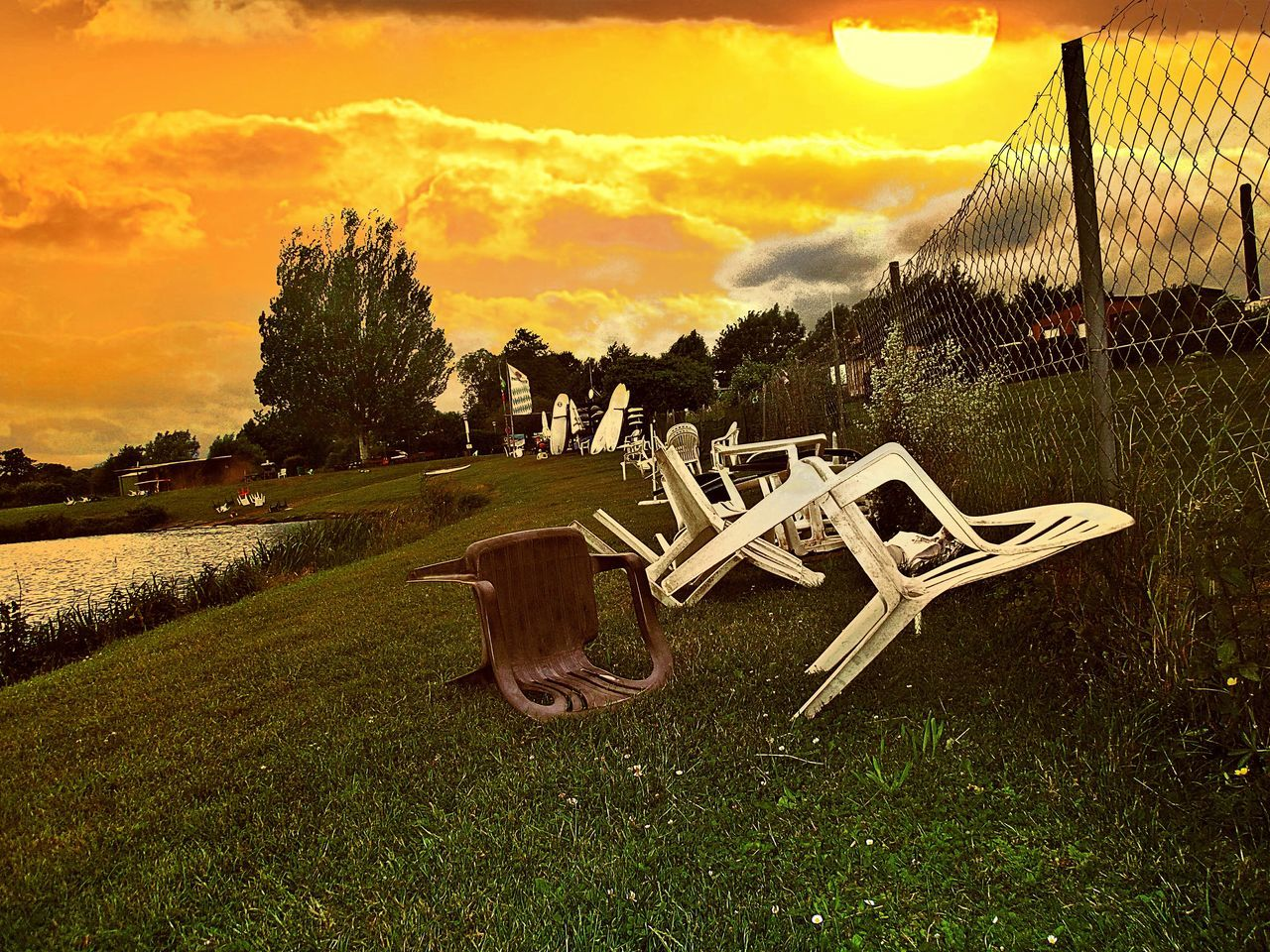 End Of A Stormy Day Chairs Lying Arround Sunset Porn Lakeshore Lakeside Surfclub Green Grass And Trees Strong Wind Summer Evening Golden Hour Summer 2017 The Great Outdoors - 2017 EyeEm Awards Lake Kinzigsee Germany🇩🇪