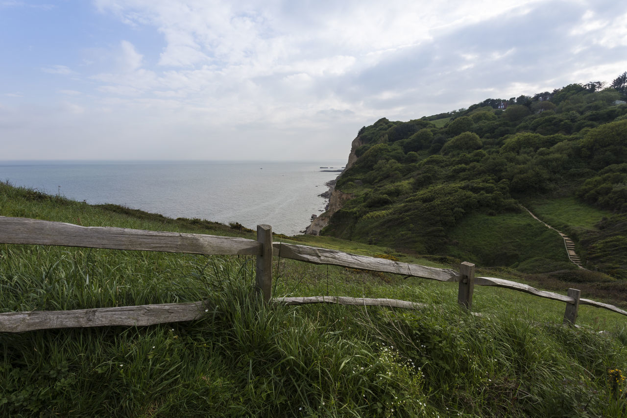 View out towards the sea from East Hill Country Park, Hastings, East Sussex, England, United Kingdom Beach Beauty In Nature Cloud - Sky Day East Hill Country Park East Sussex England Fence Grass Green Color Hastings Hi Horizon Over Water Landscape Nature No People Outdoors Scenics Sea Seaside Sky Tranquil Scene Tranquility United Kingdom Water