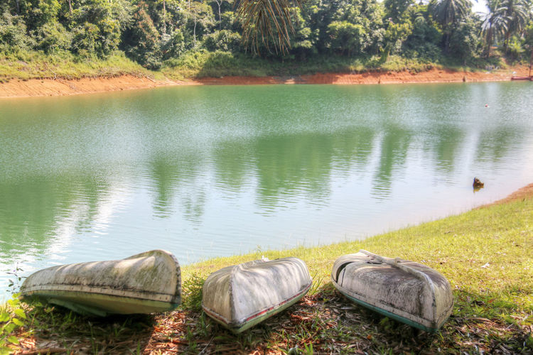 Kenyir Lake is the largest man-made lake in South-East Asia. Covering an area of 260,000 hectares, it is home to some 300 species of freshwater fishes Beauty In Nature Boat Canoe Kenyir Kenyir Lake Lake Lakeside Malaysia Nature No People Outdoors Reflection Terengganu Tranquility Tree Tropical Climate Tropical Jungle Tropical Paradise Water