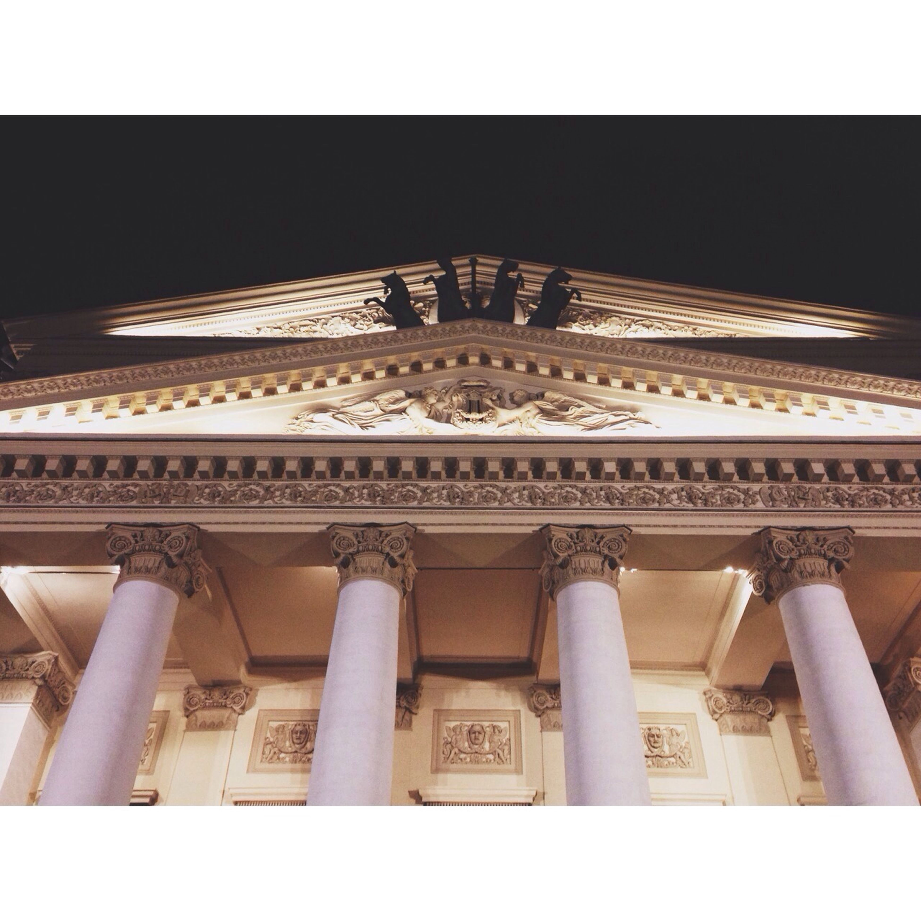 architecture, built structure, low angle view, building exterior, history, architectural column, transfer print, famous place, travel destinations, column, auto post production filter, tourism, art and craft, religion, international landmark, travel, architectural feature, ornate, carving - craft product, capital cities