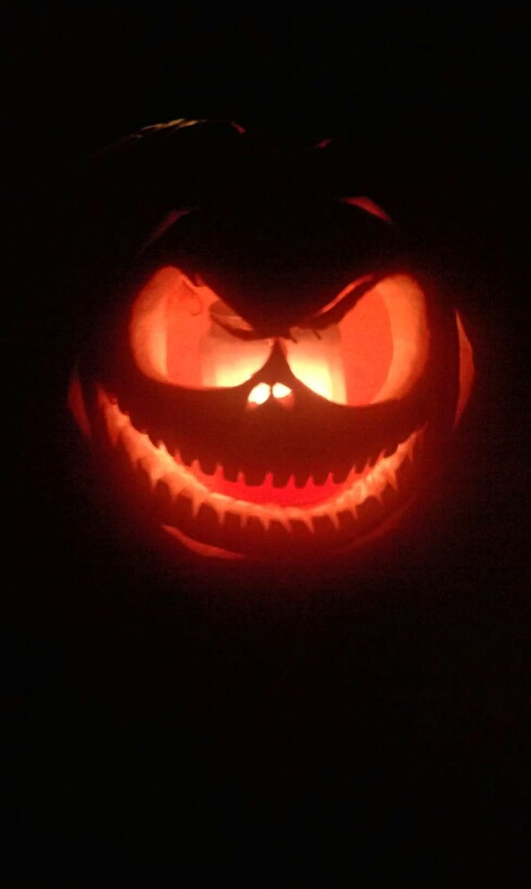 celebration, halloween, pumpkin, anthropomorphic face, no people, night, tradition, flame, illuminated, black background, close-up, jack o lantern, indoors