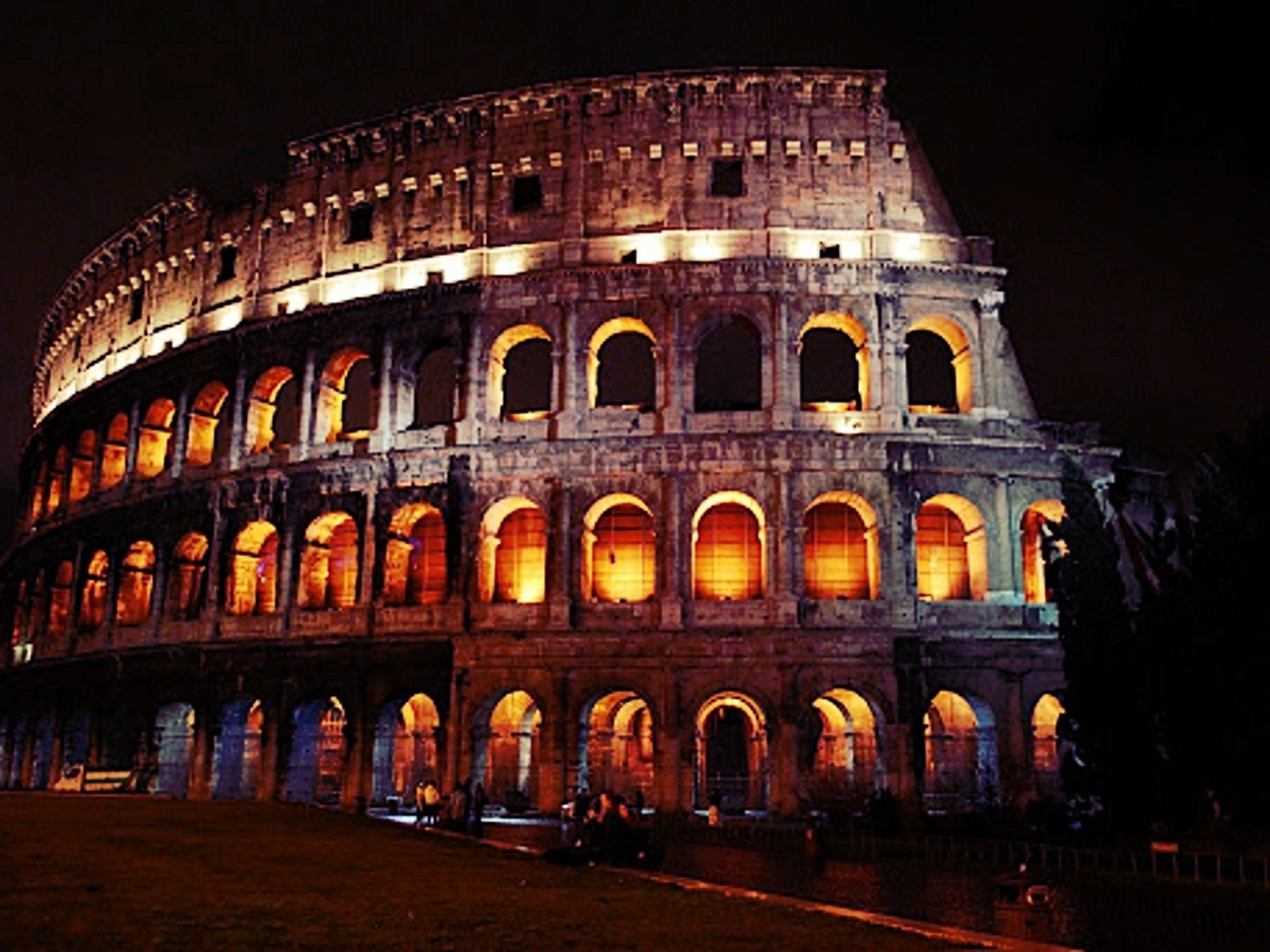 architecture, built structure, arch, building exterior, history, famous place, travel destinations, tourism, night, international landmark, travel, culture, facade, low angle view, illuminated, tourist, capital cities, coliseum, architectural column, large group of people