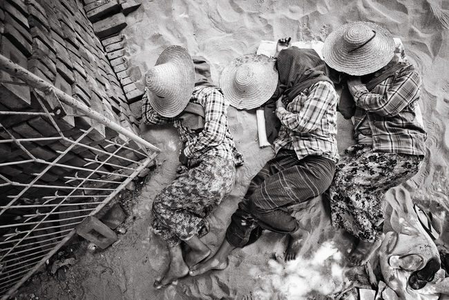 Sand Dreams Three young girls, who work as masons, decide to take a little rest, sleeping on the sand they will use for cement. Protected from the sun by their straw hats, they seem to fly in their sand dreams. Bagan Bricks Dreaming Dreams From Top To Bottom Hidden Faces In Row Myanmar Poverty Poverty Lives. Sand Sleeping Straw Hat Take A Rest Three Girls Young Workers