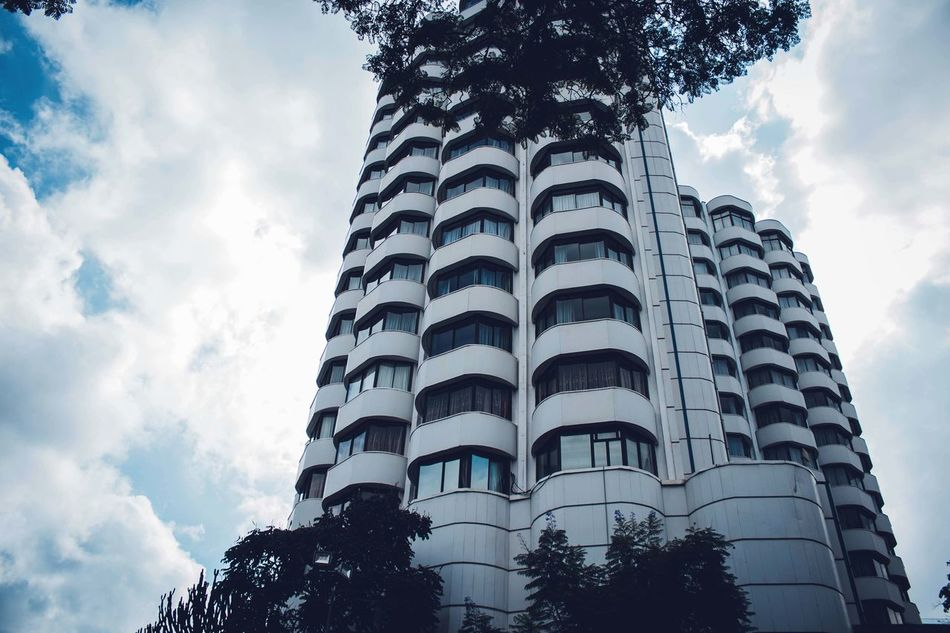 Low Angle View Architecture Sky Cloud - Sky Built Structure Skyscraper Building Exterior Tree Modern Outdoors City No People Day EyeEm Gallery Streetphotography Canon Canonphotography Africa EyeEm Detail
