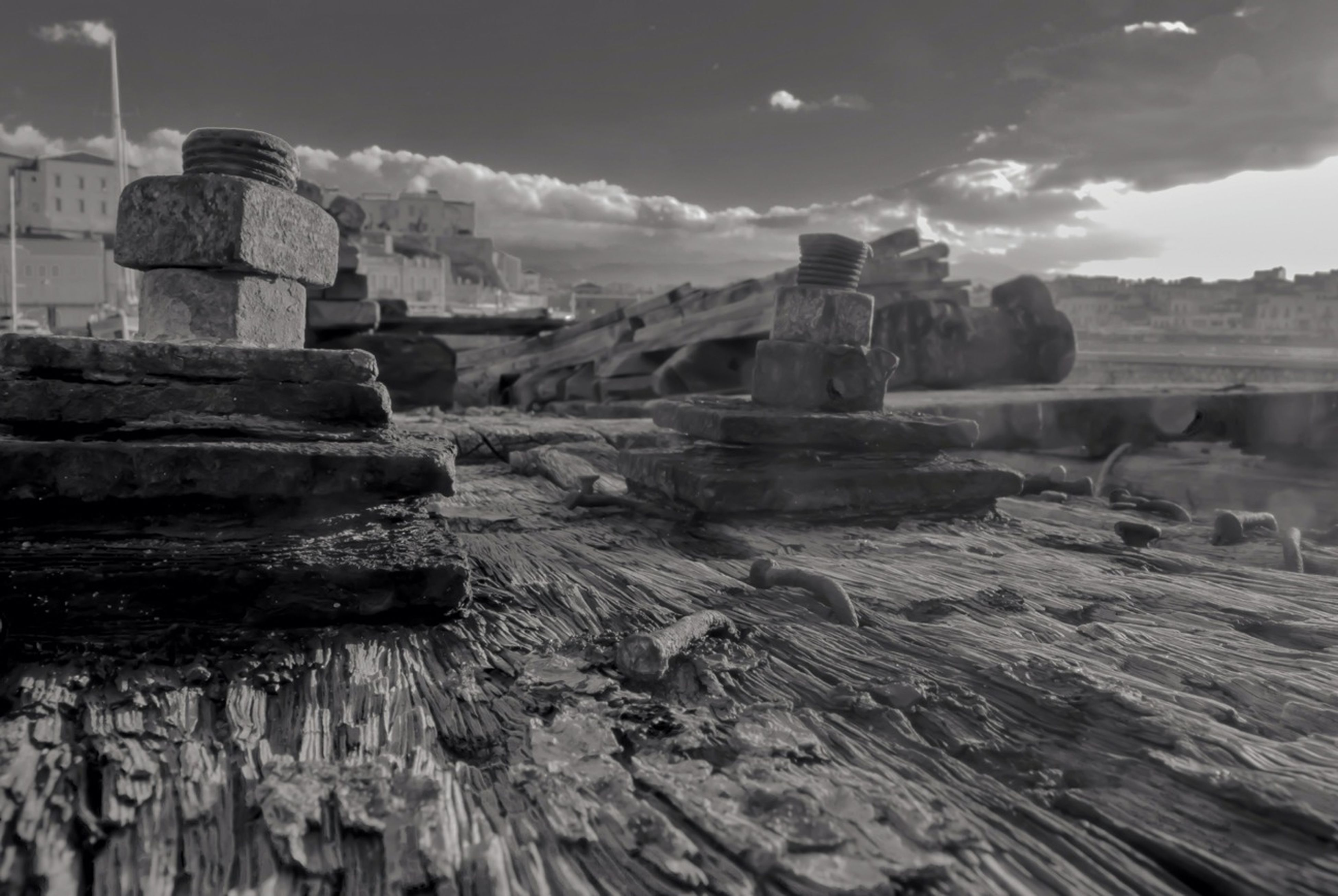 sky, rock - object, rock formation, tranquility, tranquil scene, cloud - sky, scenics, nature, rock, landscape, travel destinations, tourism, old ruin, geology, stack, famous place, cloud, outdoors, travel, day