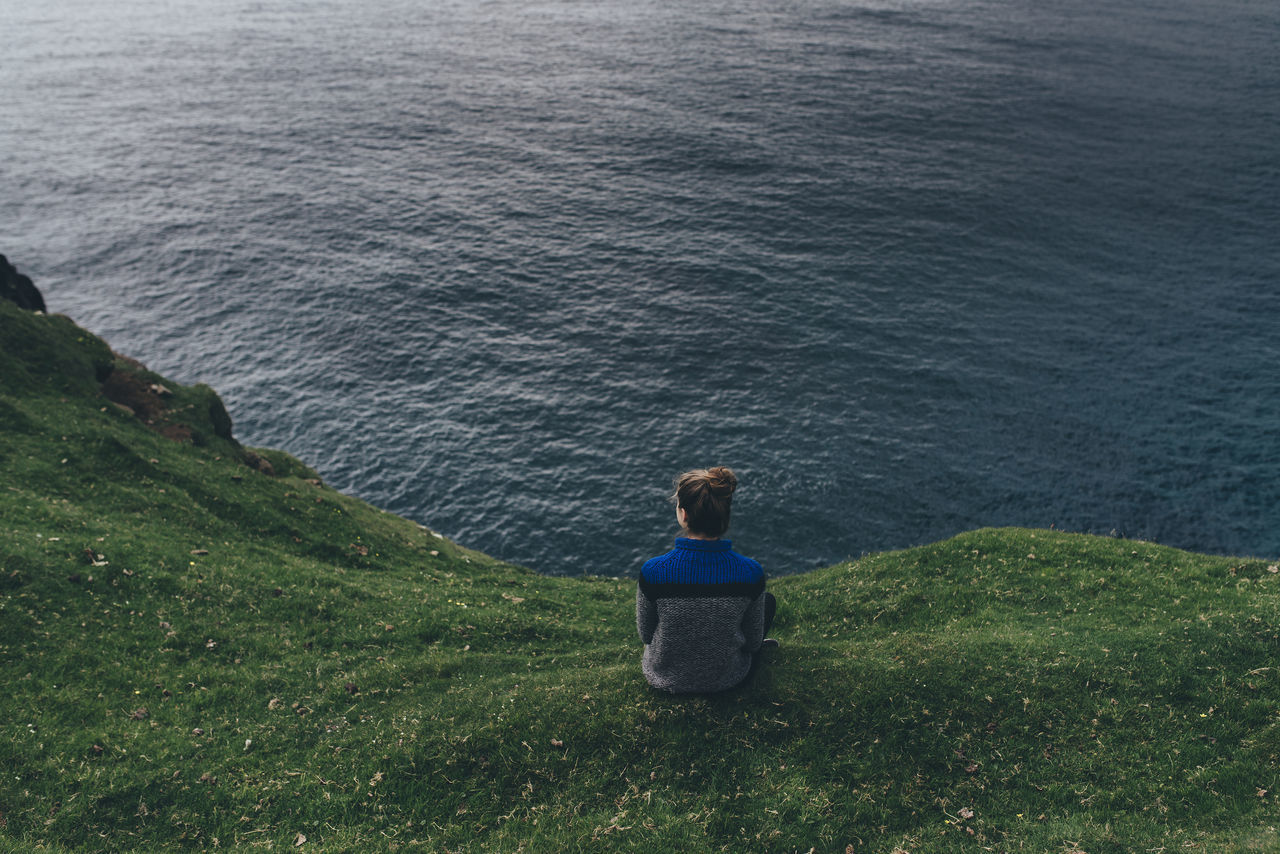 Beauty In Nature Day Faroe Islands Full Length Grass High Angle View Horizon Over Water Nature One Person Outdoors People Real People Rear View Scenics Sea Sitting Standing Tranquil Scene Tranquility Water Women