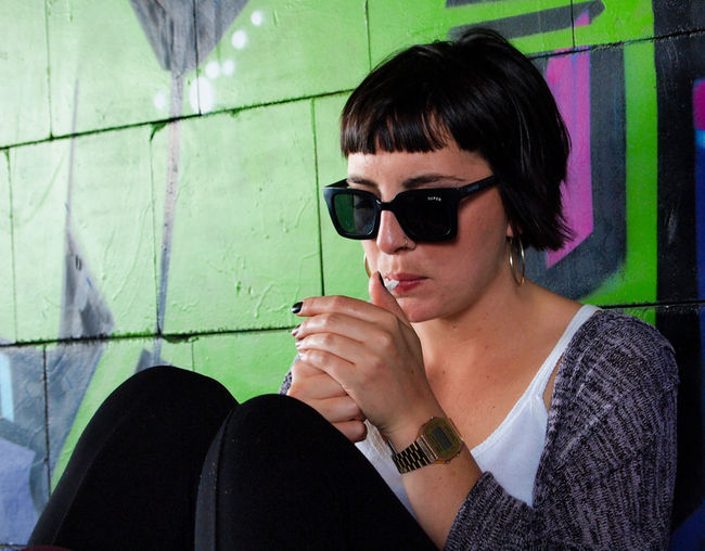 Actress Alternative Berlin Casual Clothing Cigarette  Cigarette Time Close-up Dark Hair Girl Graffiti Green Green Color Like A Star People And Places Person Portrait Portrait Of A Woman Sitting Style Teufelsberg Wall Woman Young Adult