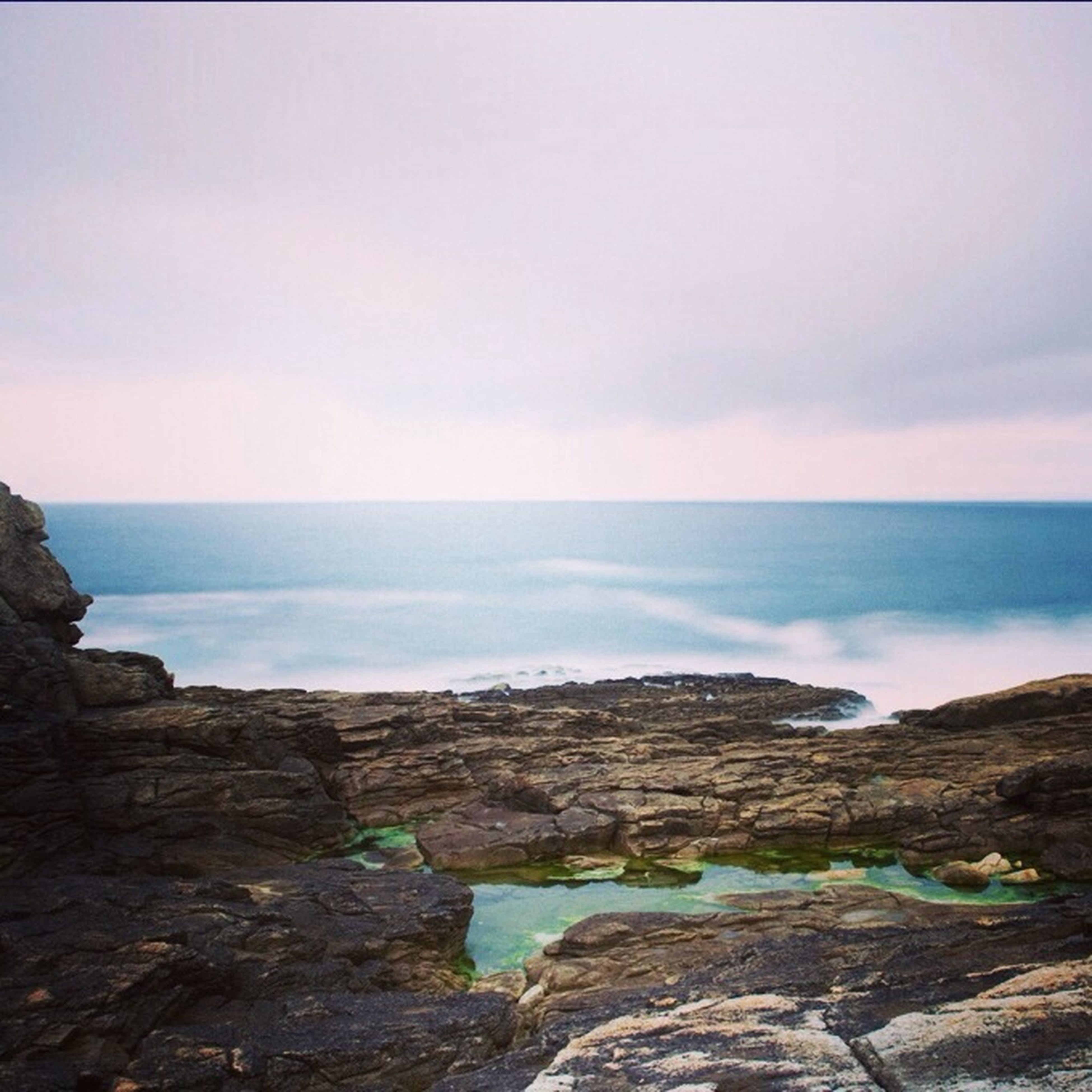 sea, horizon over water, scenics, rock - object, water, tranquil scene, beauty in nature, sky, tranquility, rock formation, nature, rock, cliff, idyllic, shore, cloud - sky, beach, remote, non-urban scene, outdoors