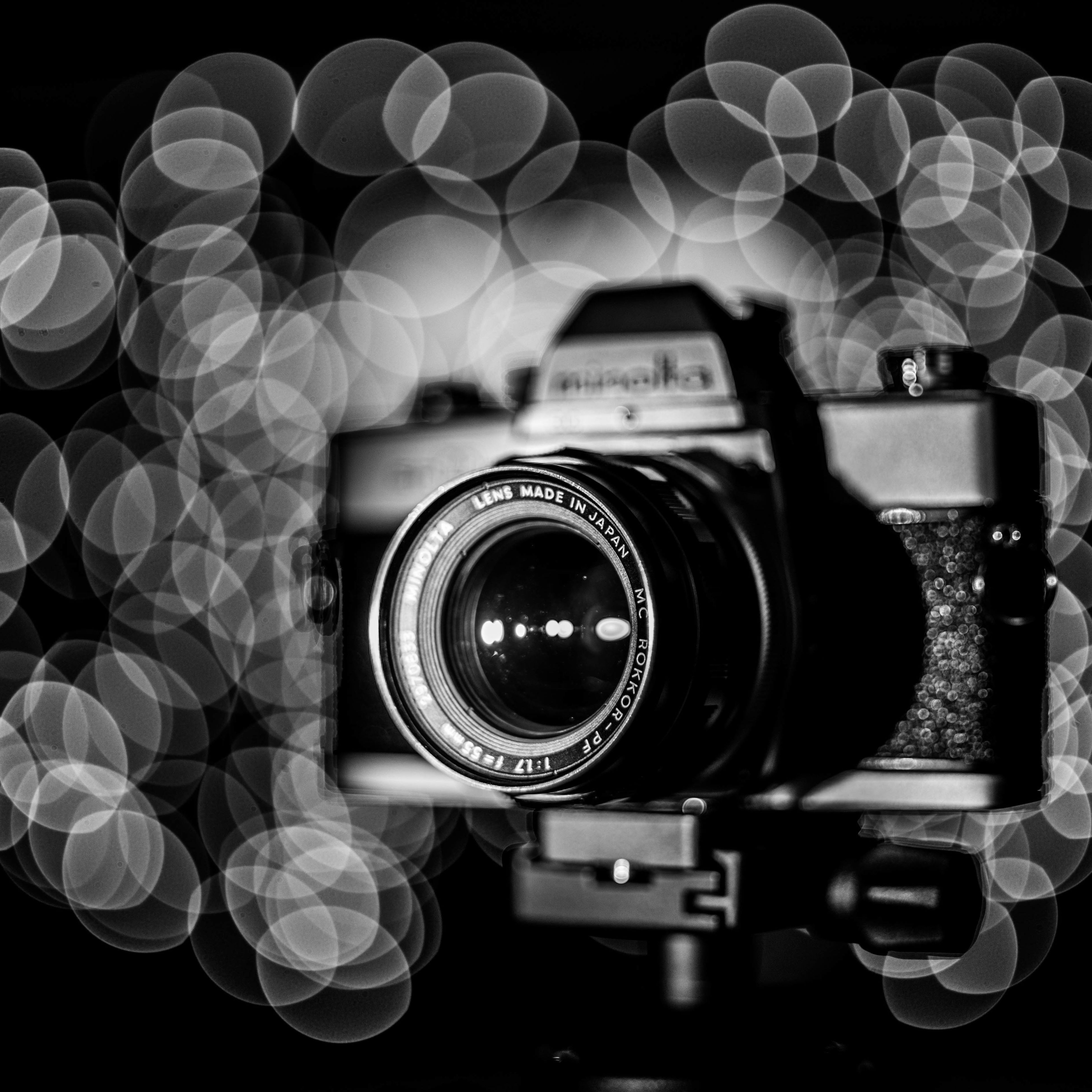 close-up, retro styled, still life, no people, focus on foreground, illuminated, modern, selective focus, black color, dark