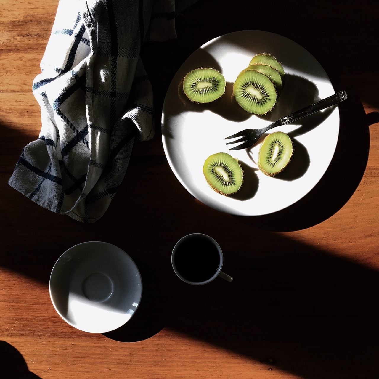 Kiwi Slices And Coffee Served On Table