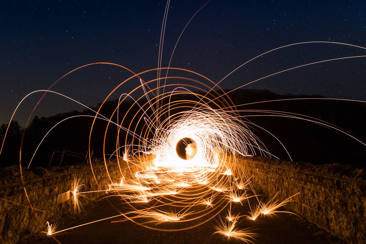 Burrator Reservoir, Dartmoor. Playing with wire wool. 6D Blurred Motion Burrator Reservoir Canon Illuminated Light Effect Long Exposure Long Exposure Shot Love Photography Motion Night No People Outdoors Samyang 20mm Sky Sparks Spinning Star - Space Stars Wire Wool