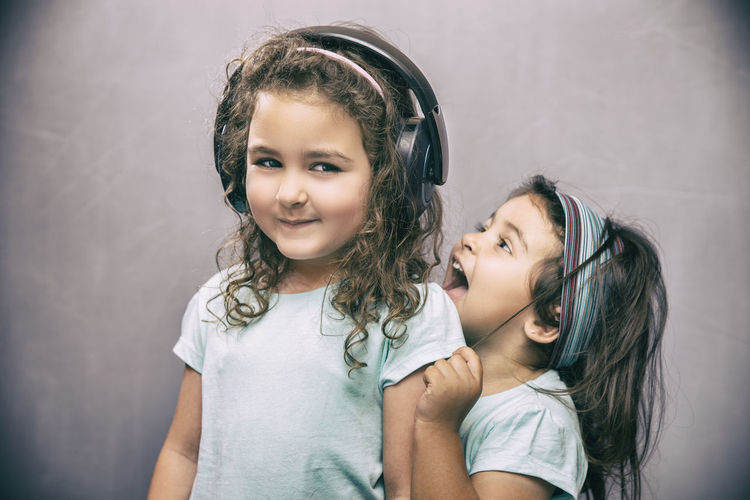 Sisters and headphones Cheerful Child Childhood Children Only Cute Females Friendship Girls Happiness Headphones Indoors  Lifestyles Music Is My Life People Portrait Smiling Togetherness