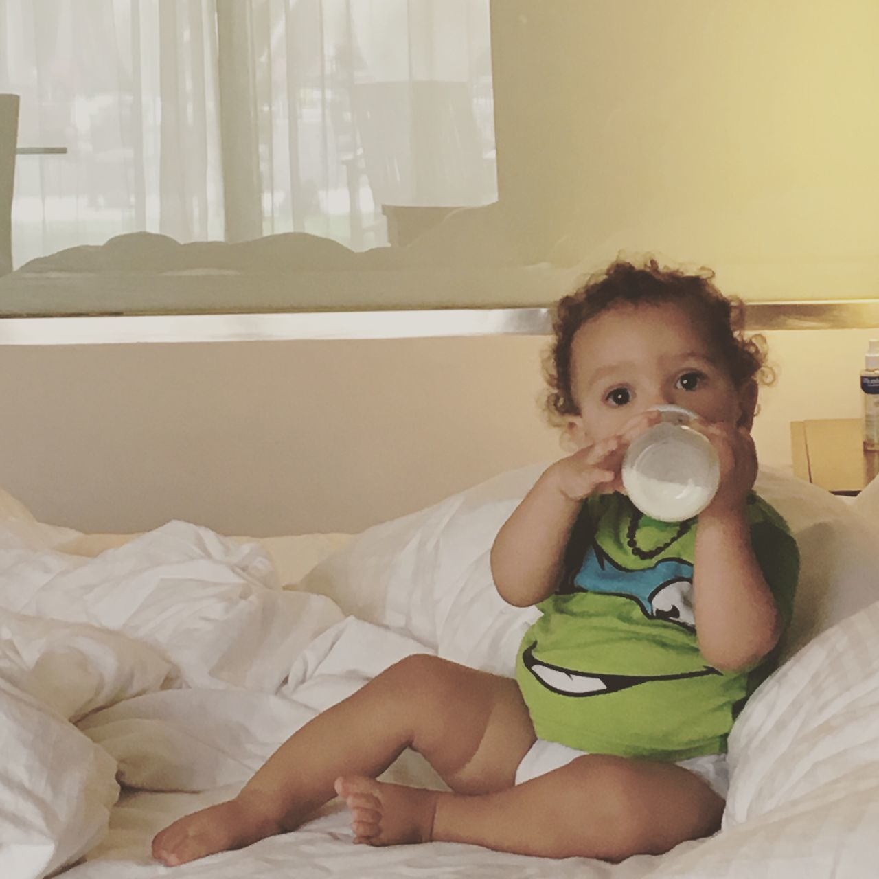 Bed Milk Baby Child Control Ninja Turtles Green White Blonde Son Childhood Drinking Bed Indoors  Innocence Bedroom Looking At Camera Home Interior Real People Cute Portrait One Person Sitting Drink Pacifier Day People First Eyeem Photo