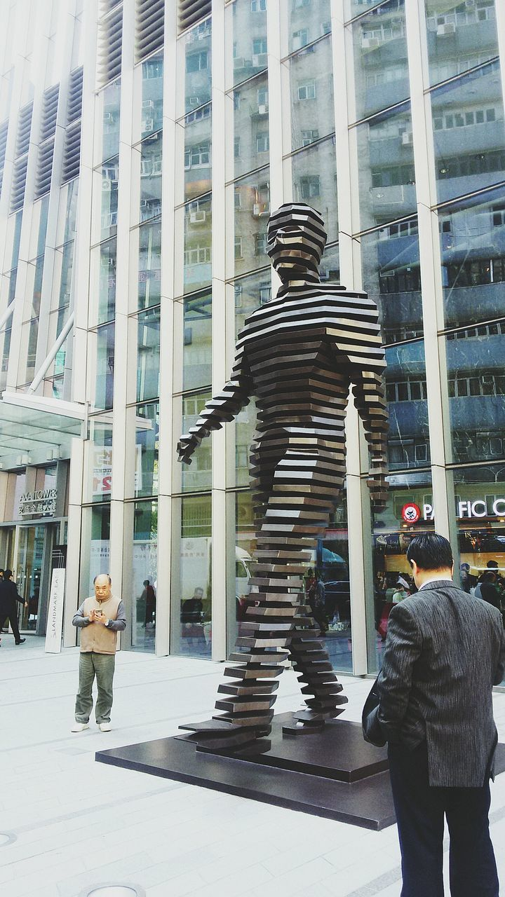 statue, architecture, sculpture, built structure, building exterior, real people, day, city, men, outdoors, full length, lifestyles, modern, one person, people