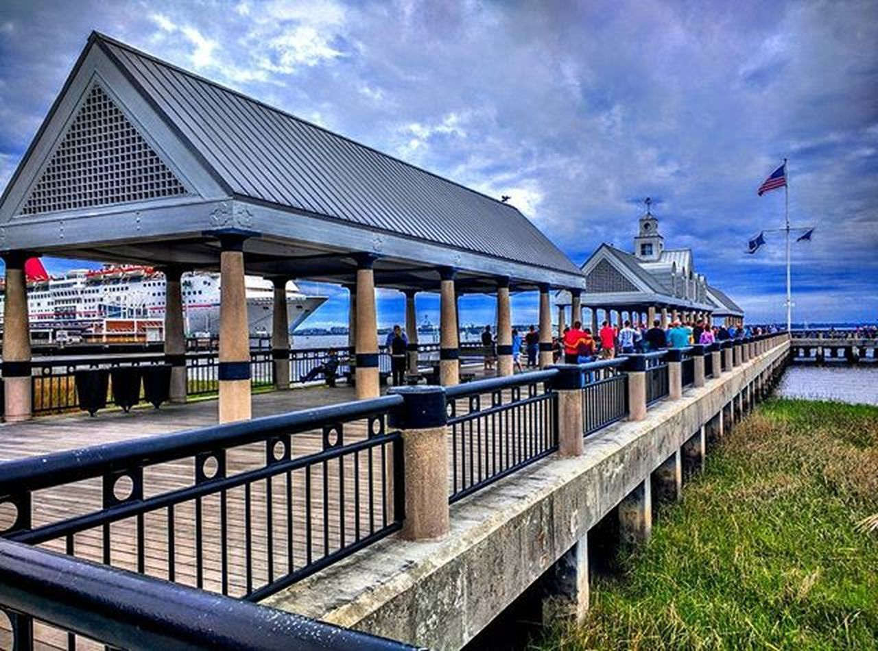 cloud - sky, architecture, built structure, building exterior, sky, outdoors, day, flag, water, beach, no people, nature, city