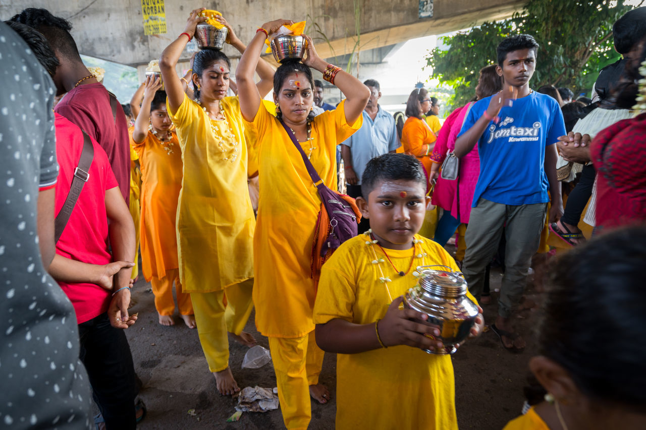 BATU CAVES, MALAYSIA - 9TH FEBRUARY 2017; Hindu devotees performing a pray session during Thaipusam festival in Batu Caves temple, celebrating Lord Murugan victory over the demon Soorapadman. Adult Batu Caves -Malaysia Competition Fan - Enthusiast Friendship Fun Happiness Hindu Gods Lifestyles Men Outdoors People Recreational Pursuit Smiling Soccer Sport Sports Uniform Teamwork Thaipusam 2017 Unity Women