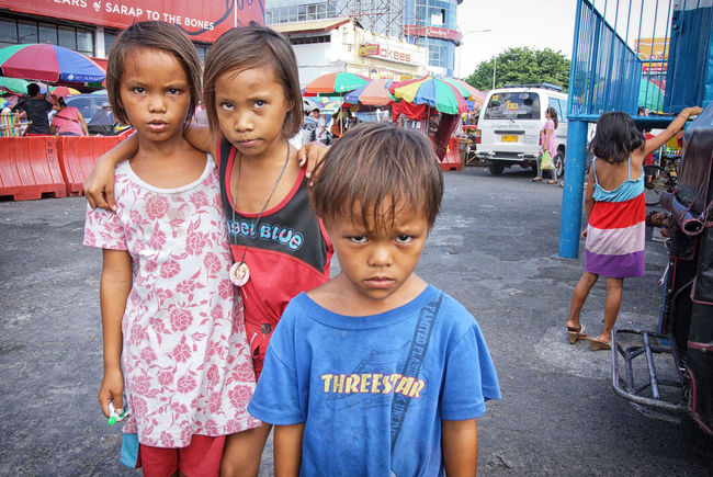 The Children of Baclaran. Baclaran Childhood Children Elementary Age Eyem Best Shots Eyem Philippines Front View Philippines Portrait Real People Standing Stare Waist Up Youth Of Today