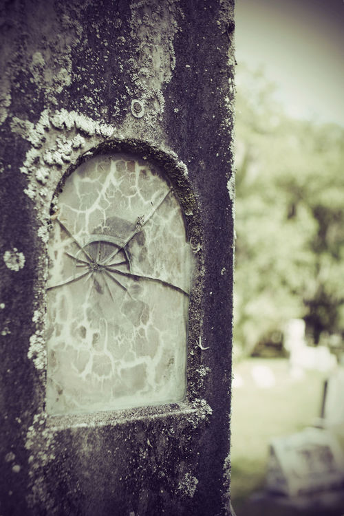 Broken Glass Cemetary Beauty Cemetery Cemetery Photography Memorial Memoriam Monuments Religion And Tradition Weathered Art Cemeteryscape Faded Faded Photo Headstone Headstones No People Peaceful Peaceful Place Religion Religious  Religious Architecture Weathered Stone Weathered Stone Face