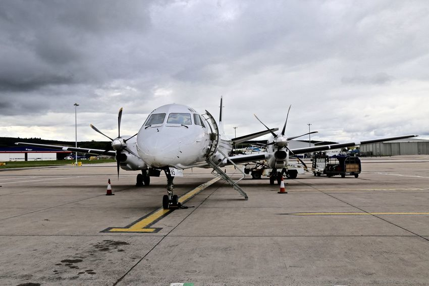 Saab 2000. Loganair. Airplane Airport Airport Runway Commercial Airplane In Front Of Mode Of Transport Transportation Travel