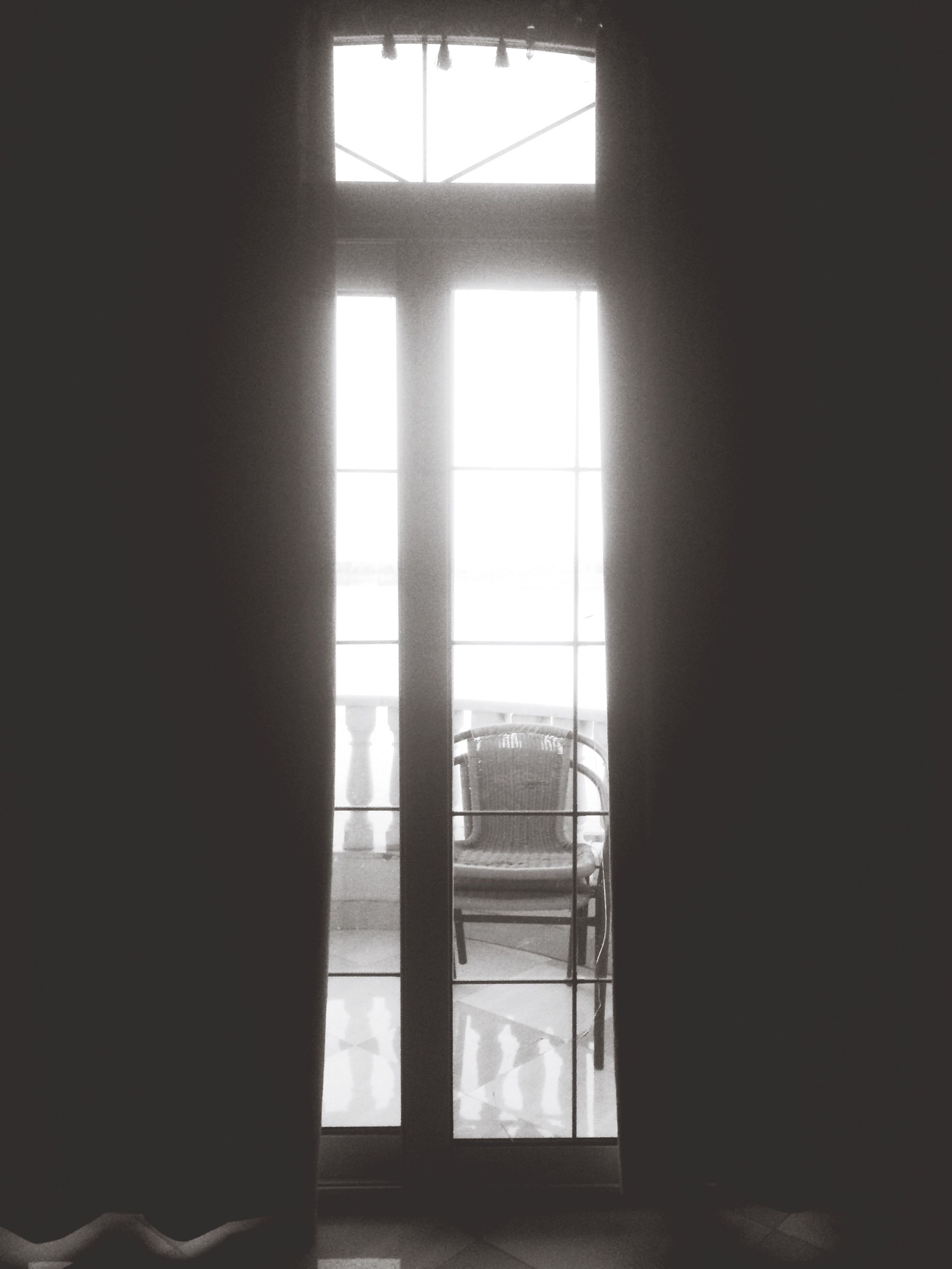 indoors, window, home interior, glass - material, transparent, curtain, architecture, built structure, house, sunlight, closed, door, window frame, day, open, no people, dark, domestic room, glass, blinds