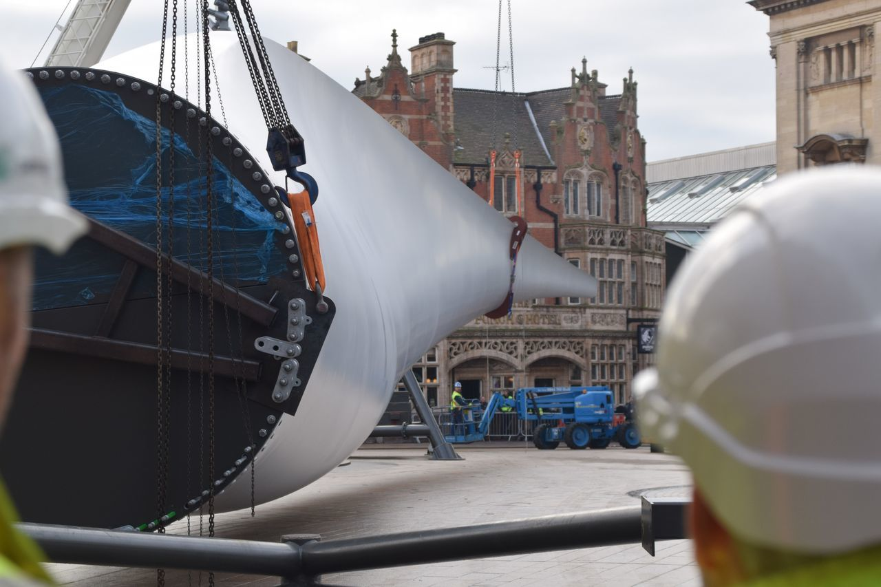 Siemens wind turbine blade is lifted into position in Hull's Queen Victoria Square (08/01/2017) during Hull 2017 City Of Culture Adult Adults Only Close-up Day Engineer Expertise Factory Harbor Headwear Hull Hull 2017 Hull City Of Culture 2017 Hull2017 Industry Occupation One Man Only Only Men Outdoors People Protective Workwear Siemens  Skill  Workers Working