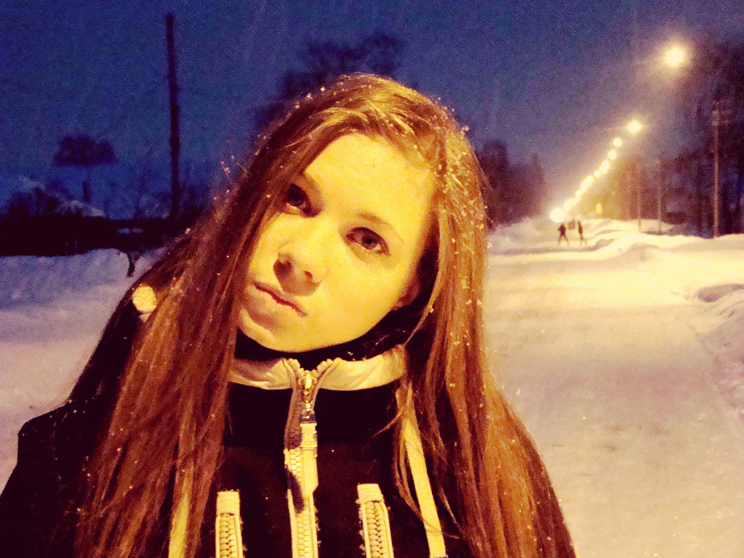 looking at camera, portrait, person, lifestyles, front view, young adult, winter, leisure activity, cold temperature, snow, smiling, happiness, young women, casual clothing, night, warm clothing, standing, headshot