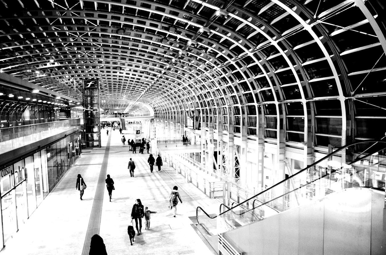 large group of people, real people, lifestyles, walking, crowd, men, subway station, indoors, commuter, built structure, motion, train - vehicle, blurred motion, transportation, women, travel, rush hour, public transportation, leisure activity, modern, illuminated, architecture, people, day, adult