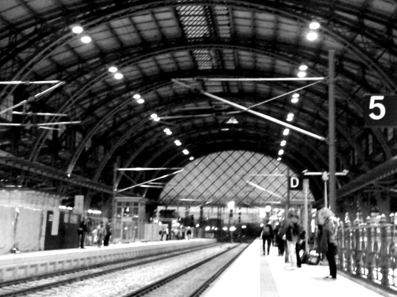 railroad station platform, transportation, railroad station, indoors, railroad track, rail transportation, illuminated, built structure, architecture, time, day, clock, no people