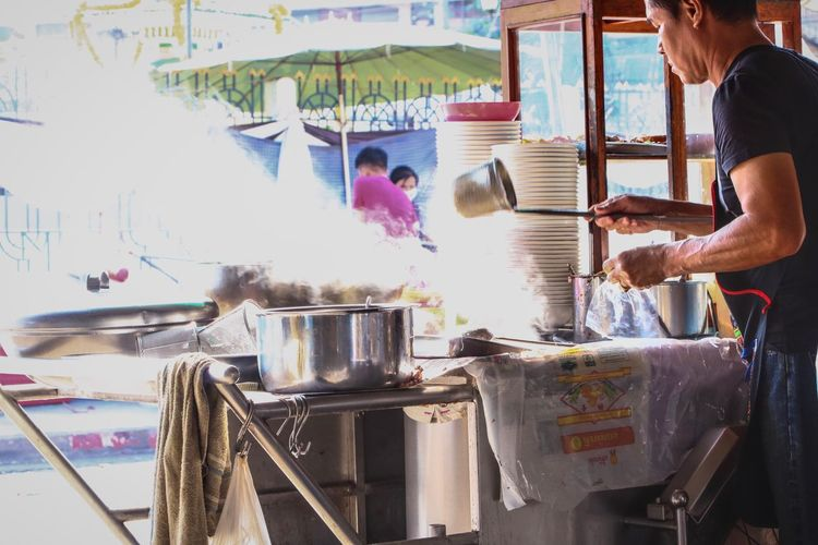 Ratchaburi, Thailand - January 22, 2017 : Chef cooking noodle at noodle shop - Thailand street food. Dericious Soup Boiling Hot Morning Sale Noodles People Adult Day Freshness One Person Heat - Temperature Indoors  Preparation  One Woman Only Food And Drink Women Adults Only Real People Adult Indoors  Only Women Working Young Adult Freshness Ready-to-eat Human Body Part
