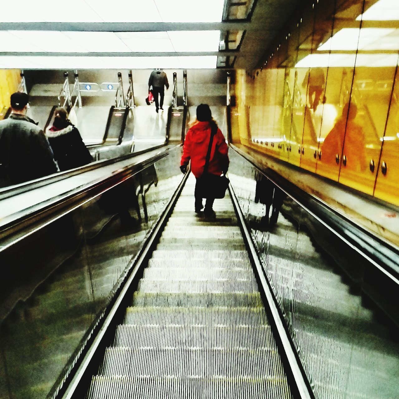 Real People Walking Indoors  Rear View Transportation Full Length Lifestyles Railroad Station Men One Person Passenger Women Railroad Station Platform Day Moving Walkway  Adults Only People Adult Only Men Wintertime Metro Subway Underground Budapest