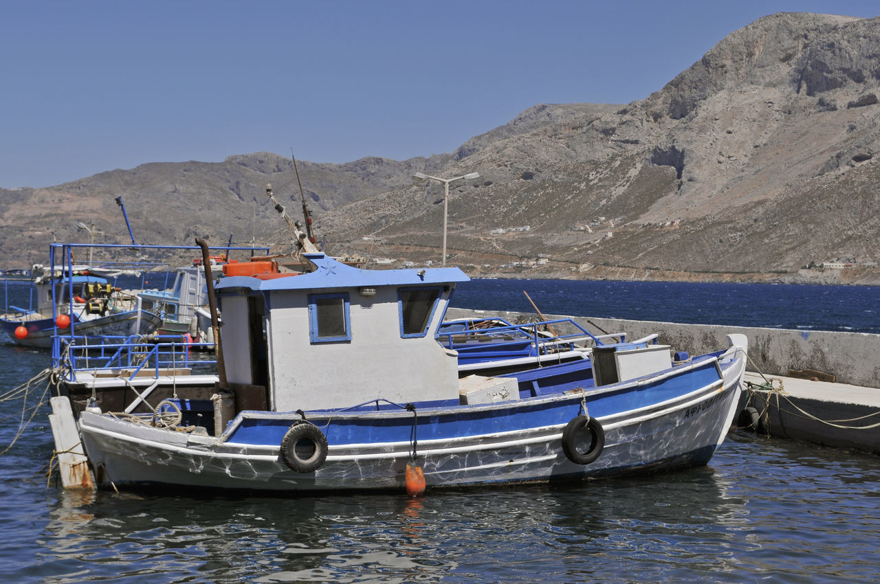 the pier of Telendos Island with Kalymnos in the background, Greece Aegean Sea Boats Dodecanese Europe Fishing Boat Fishing Boats Greece Harbour Horizontal Island Islet Kalymnos Mediterranean  Moored No People Pier Quay Telendos Travel