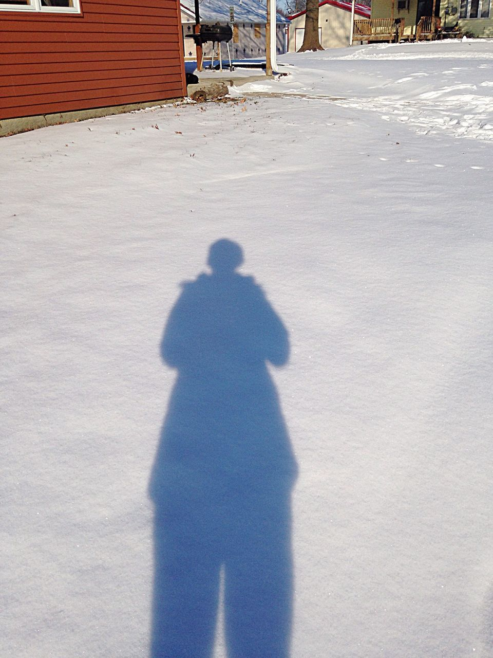 High Angle View Of Person Shadow On Snow Covered Street
