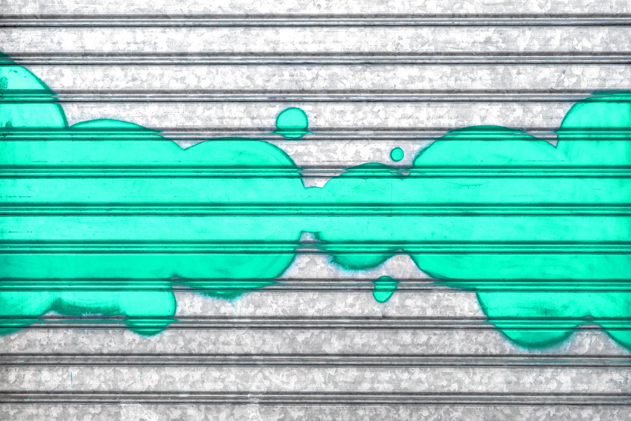 Turquoise bubbles painted with spray paint on a roller shutter. Abstract Art Background Brightly Bubbles Closeup Colorful Design Drawing Empty Frame Green Greenish Grunge Nobody Painting Pattern Shape Spray Street Symbol Texture Turquoise Vintage Wall