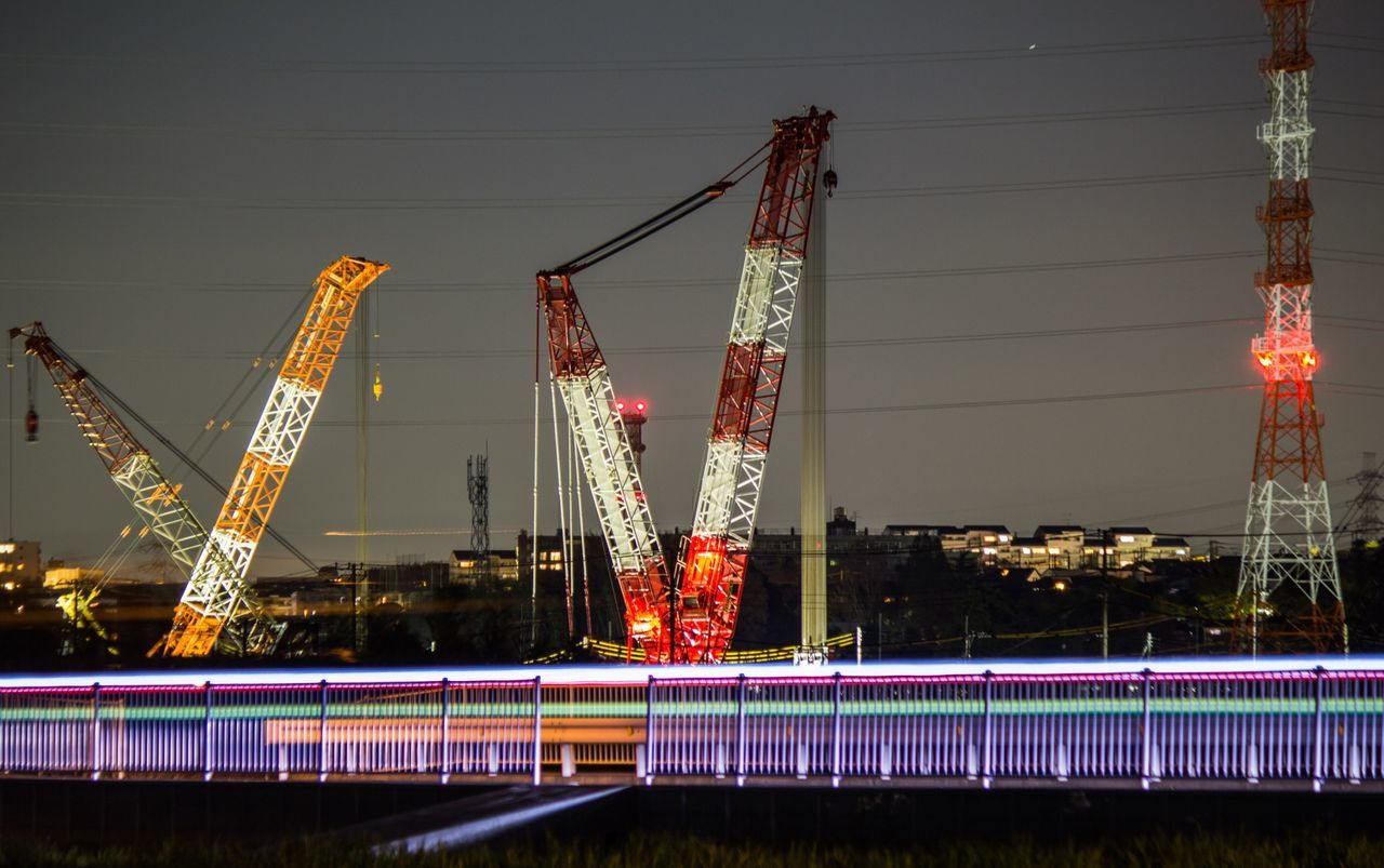 illuminated, night, long exposure, water, motion, crane - construction machinery, no people, light trail, outdoors, architecture, built structure, industry, building exterior, city, sky