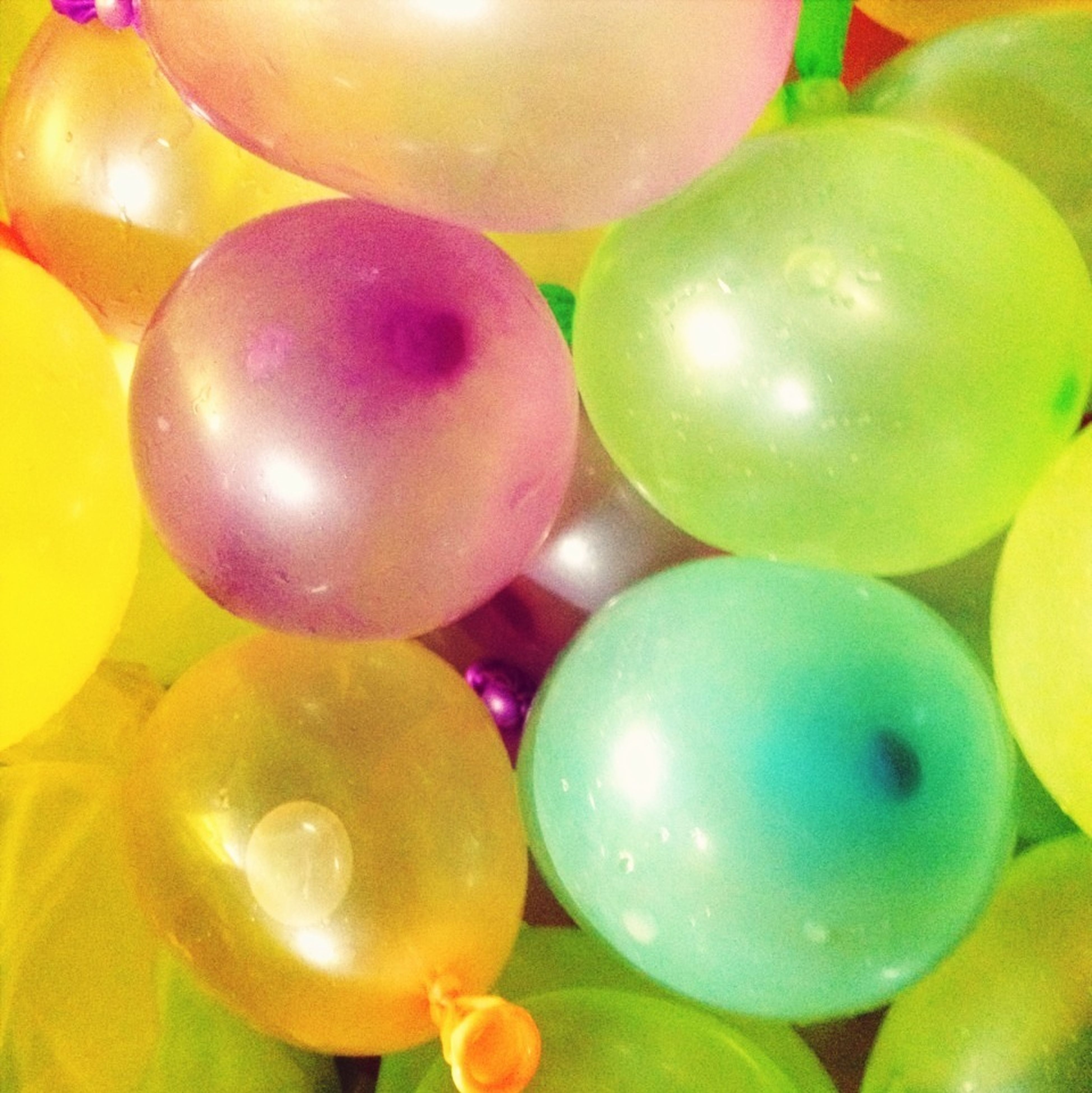 balloon, food and drink, sphere, close-up, multi colored, freshness, full frame, fruit, ball, abundance, indoors, healthy eating, food, large group of objects, backgrounds, celebration, still life, hanging, green color, variation