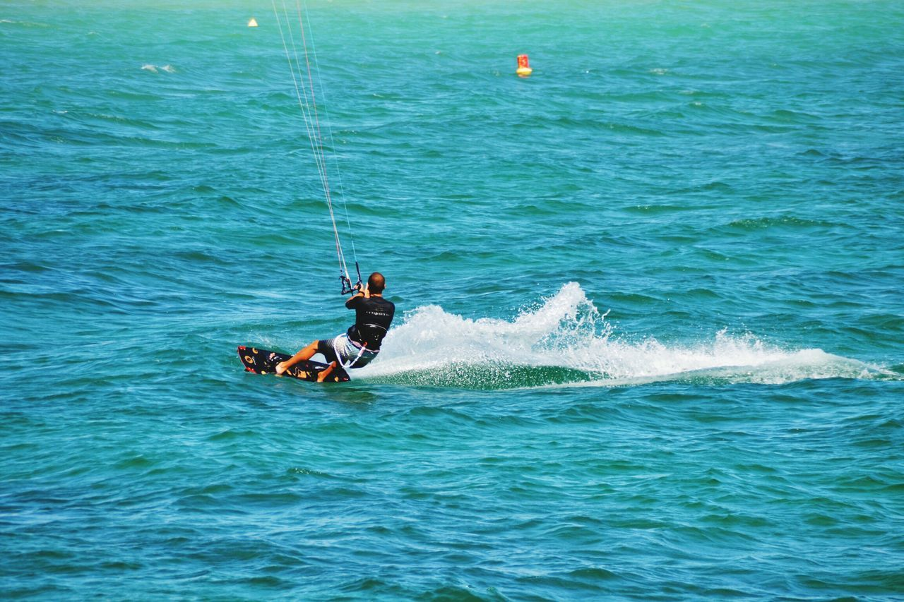Sea Waterfront Water Nautical Vessel Real People Sport Motion Men Wave Transportation Outdoors Skill  Leisure Activity Adventure Beauty In Nature Day Nature One Person Aquatic Sport Extreme Sports Kite Kitesurf Kitesurfing Beach Activity