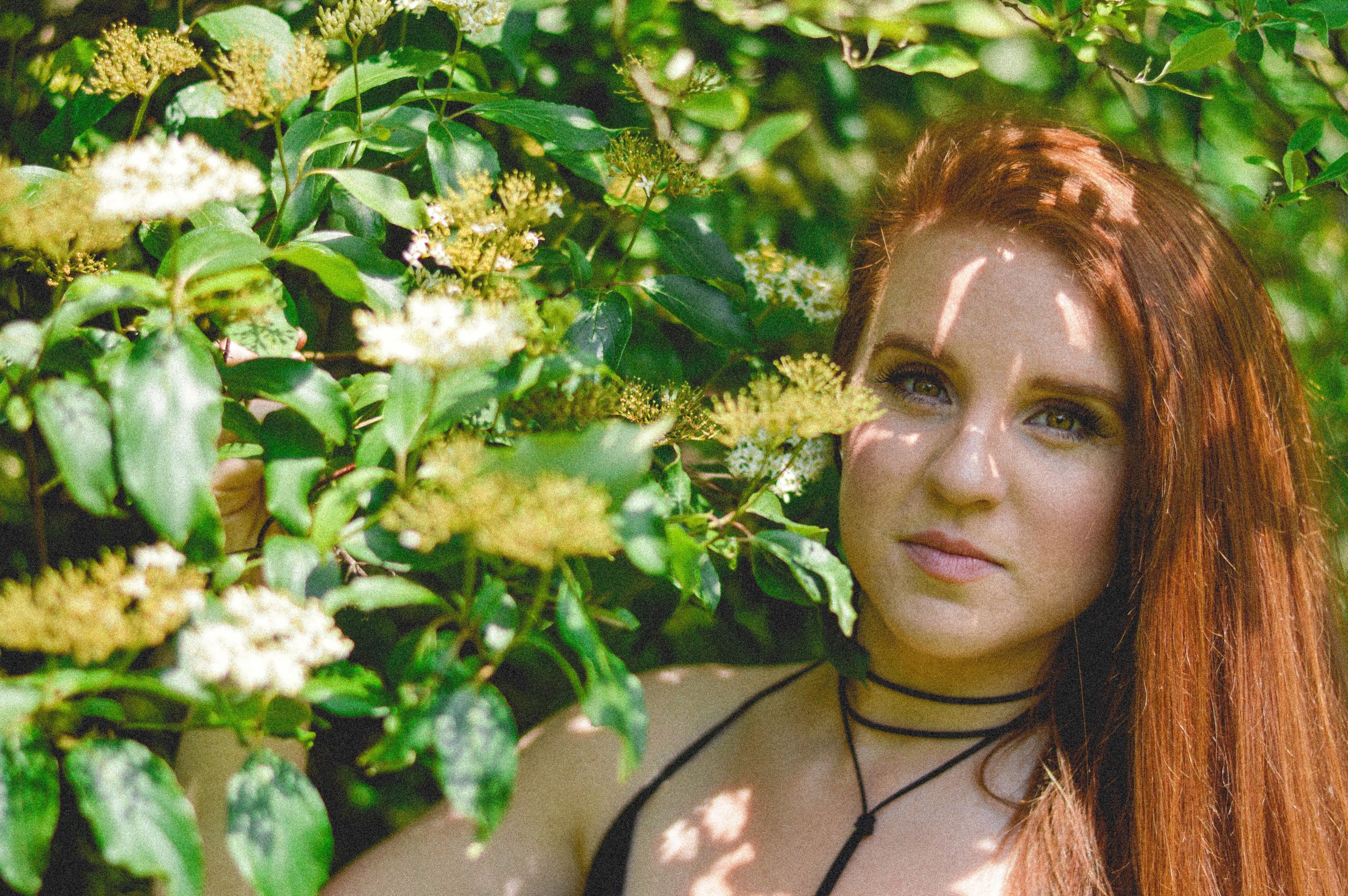 redhead, looking at camera, one person, headshot, beautiful woman, day, portrait, outdoors, tree, young adult, sunlight, nature, beauty, young women, flower, real people, close-up, beauty in nature, one young woman only, adults only, adult, people