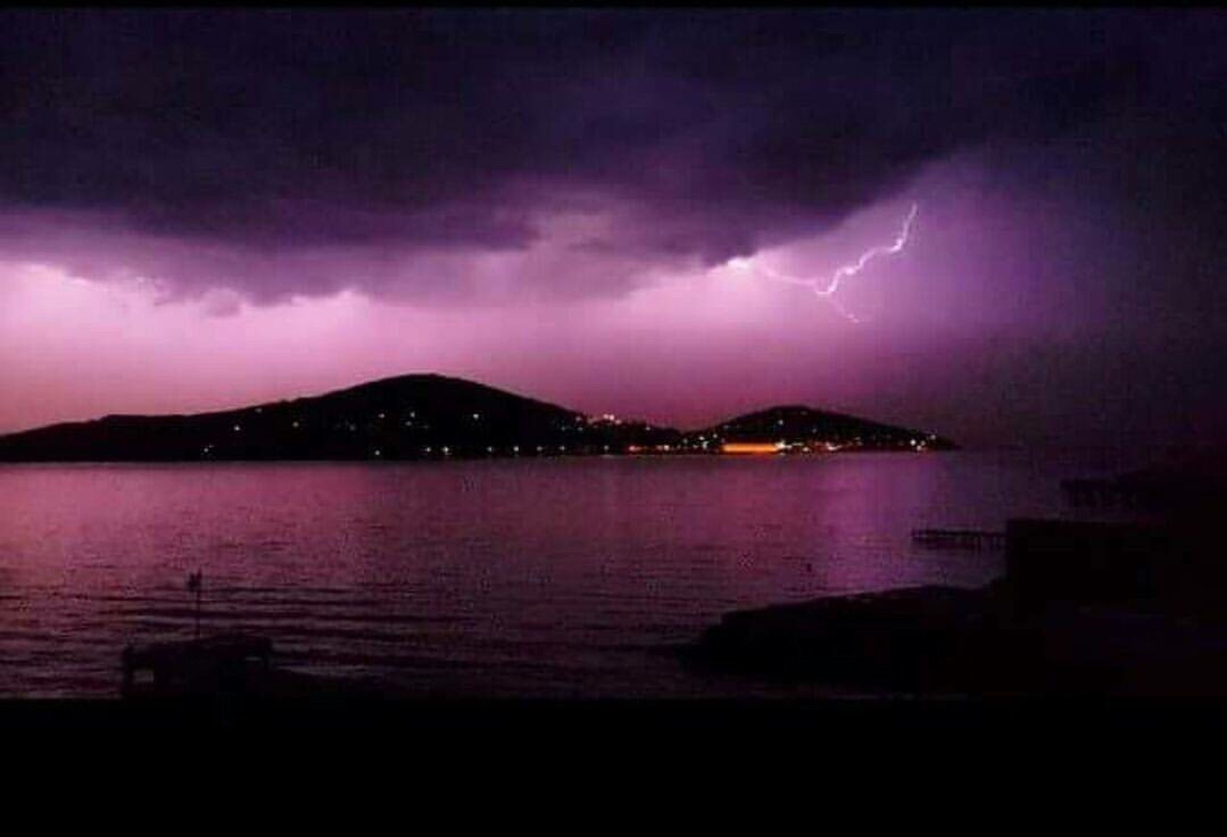 dramatic sky, storm cloud, cloud - sky, scenics, weather, storm, water, atmospheric mood, lightning, thunderstorm, illuminated, sky, power in nature, night, sea, mountain, atmosphere, tranquil scene, beauty in nature, overcast, travel destinations, tranquility, ominous, nature, dark, environment, cloud, forked lightning, cloudscape, majestic