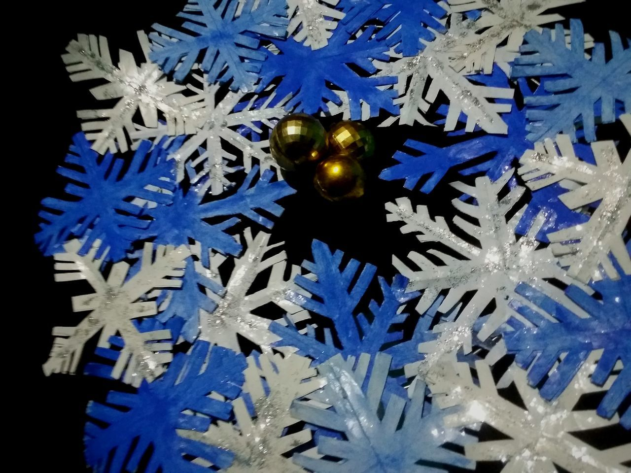 High Angle View Of Christmas Decorations On Black Background